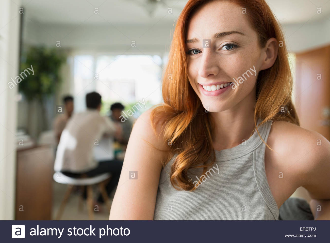 Portrait of smiling woman with red hair Photo Stock