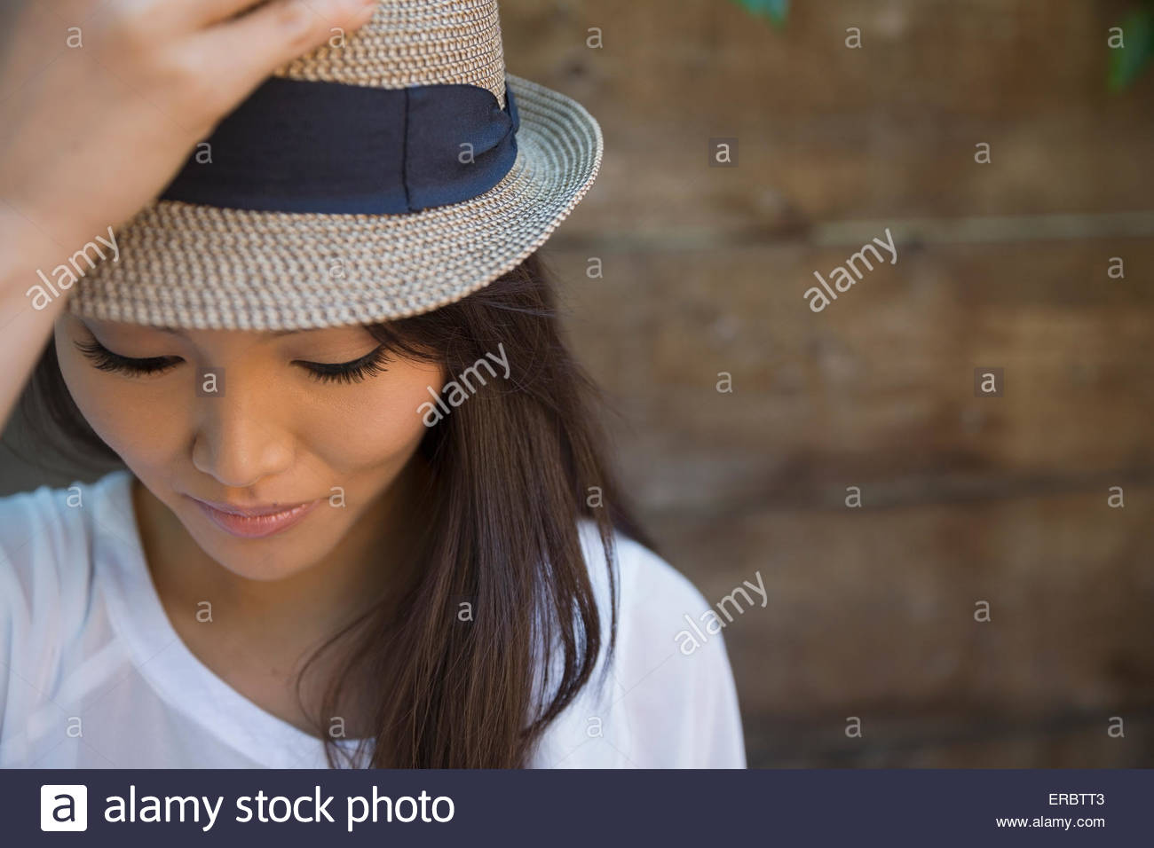 Grave Portrait woman in hat looking down Photo Stock