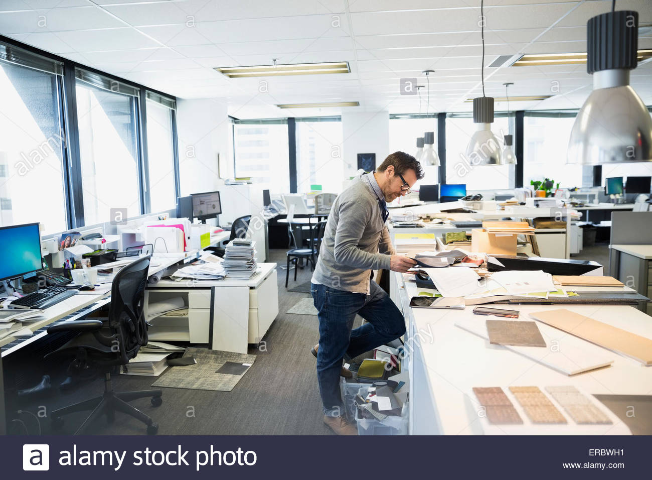 Interior Designer working at table in office Photo Stock