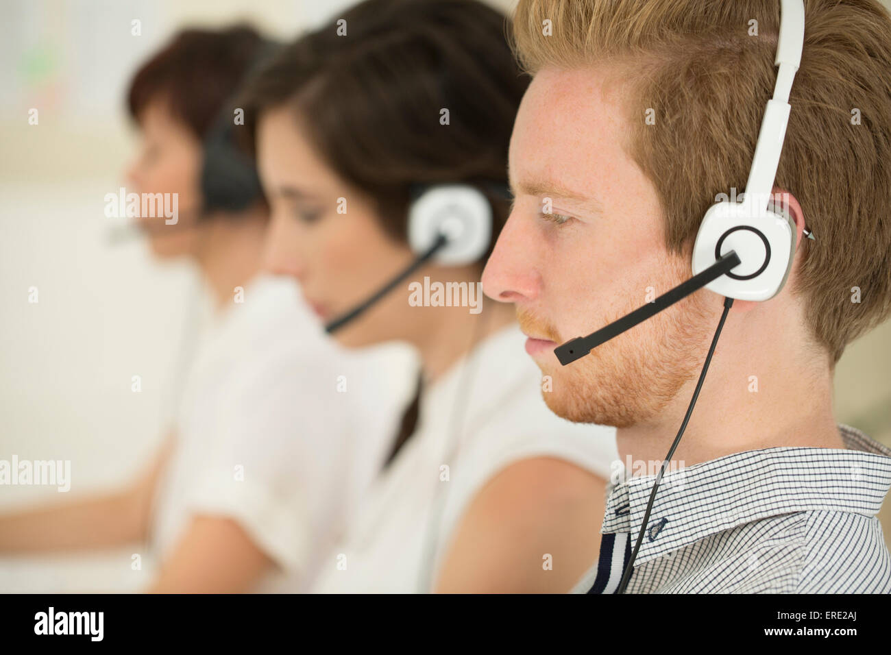 Close up of business people wearing headsets Banque D'Images