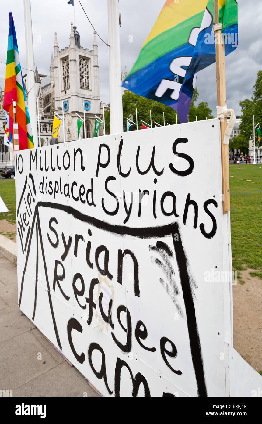 Grève de la paix dans le camp de réfugiés syriens affiche de la place du Parlement - Londres, Grande Photo Stock