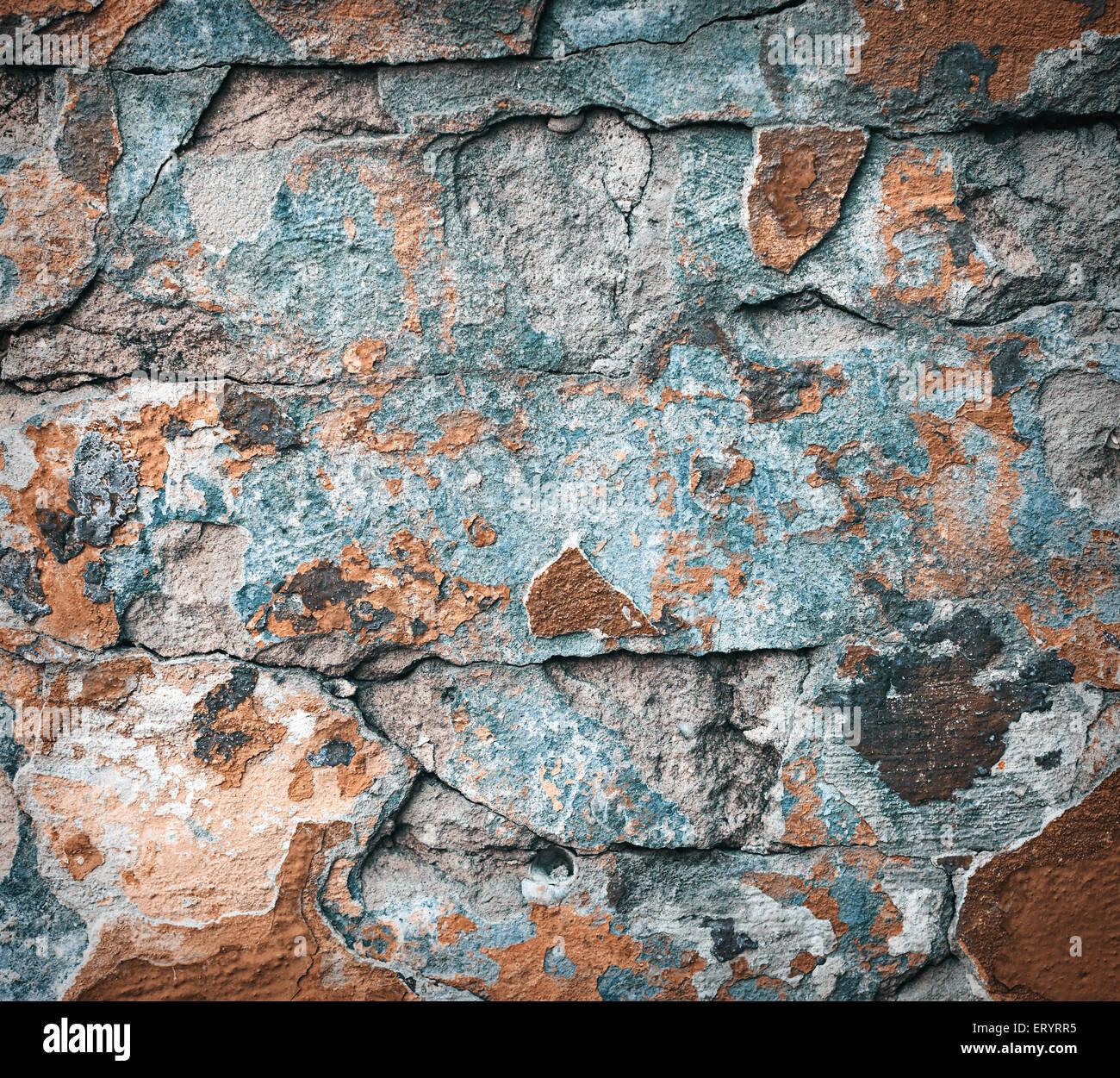 Arrière-plan de la texture du mur de brique colorée. la maçonnerie. L'écaillage de la peinture ...