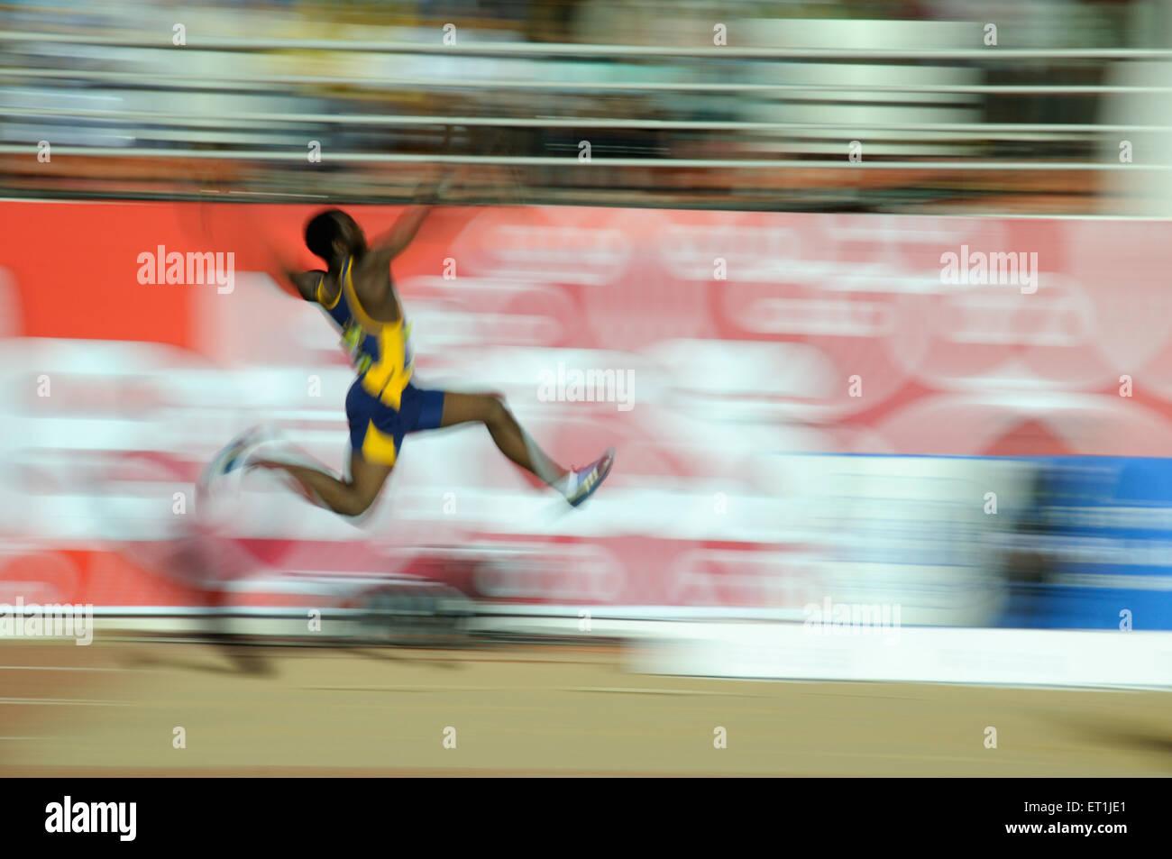 La tentative de l'athlète; saut en longueur; Pune Maharashtra; Inde 16 octobre 2008 NOMR Photo Stock