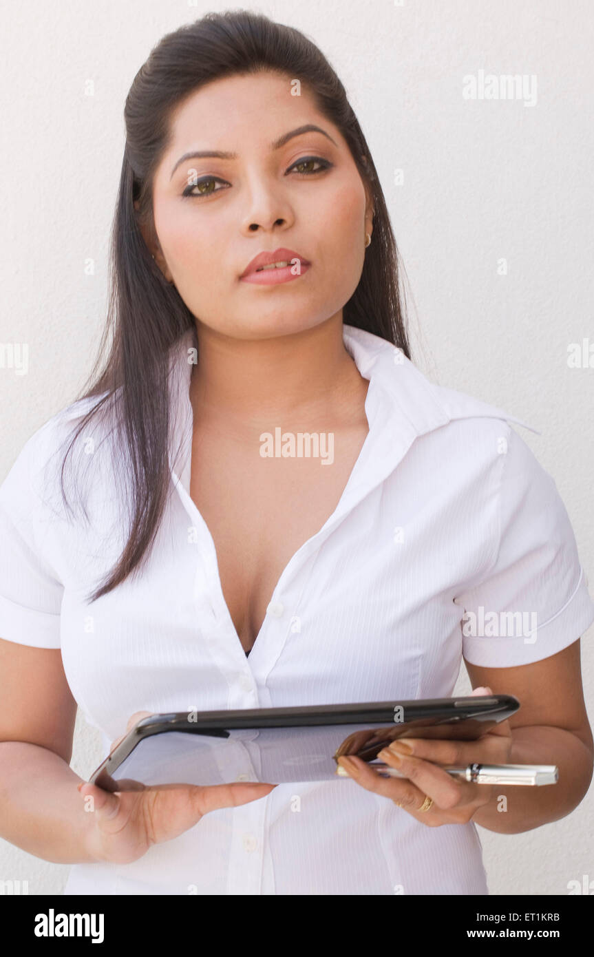 Girl holding touchpad Pune Maharashtra Inde Asie M.# 686X Photo Stock
