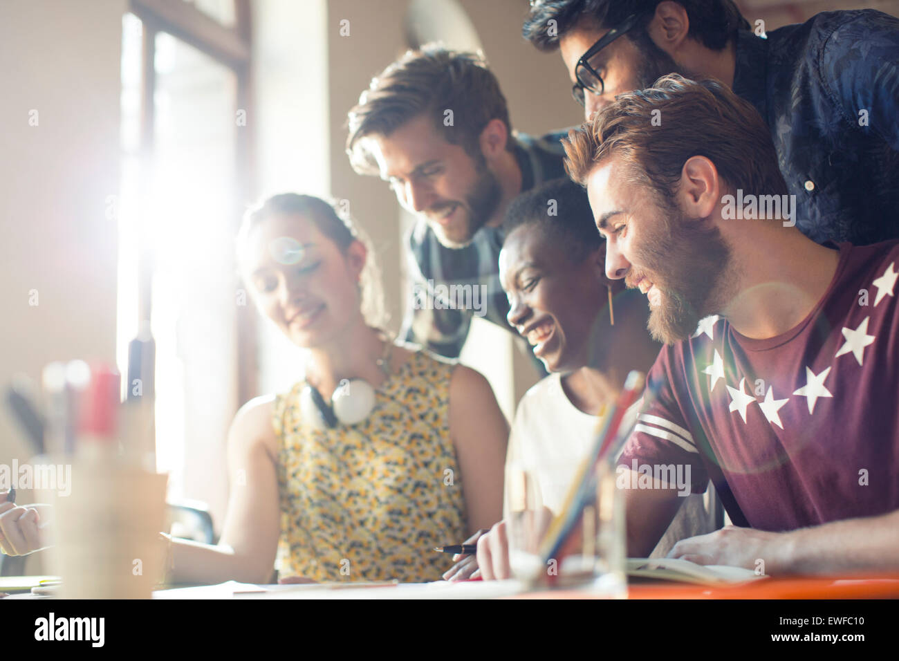 Creative business people sitting in office meeting Photo Stock