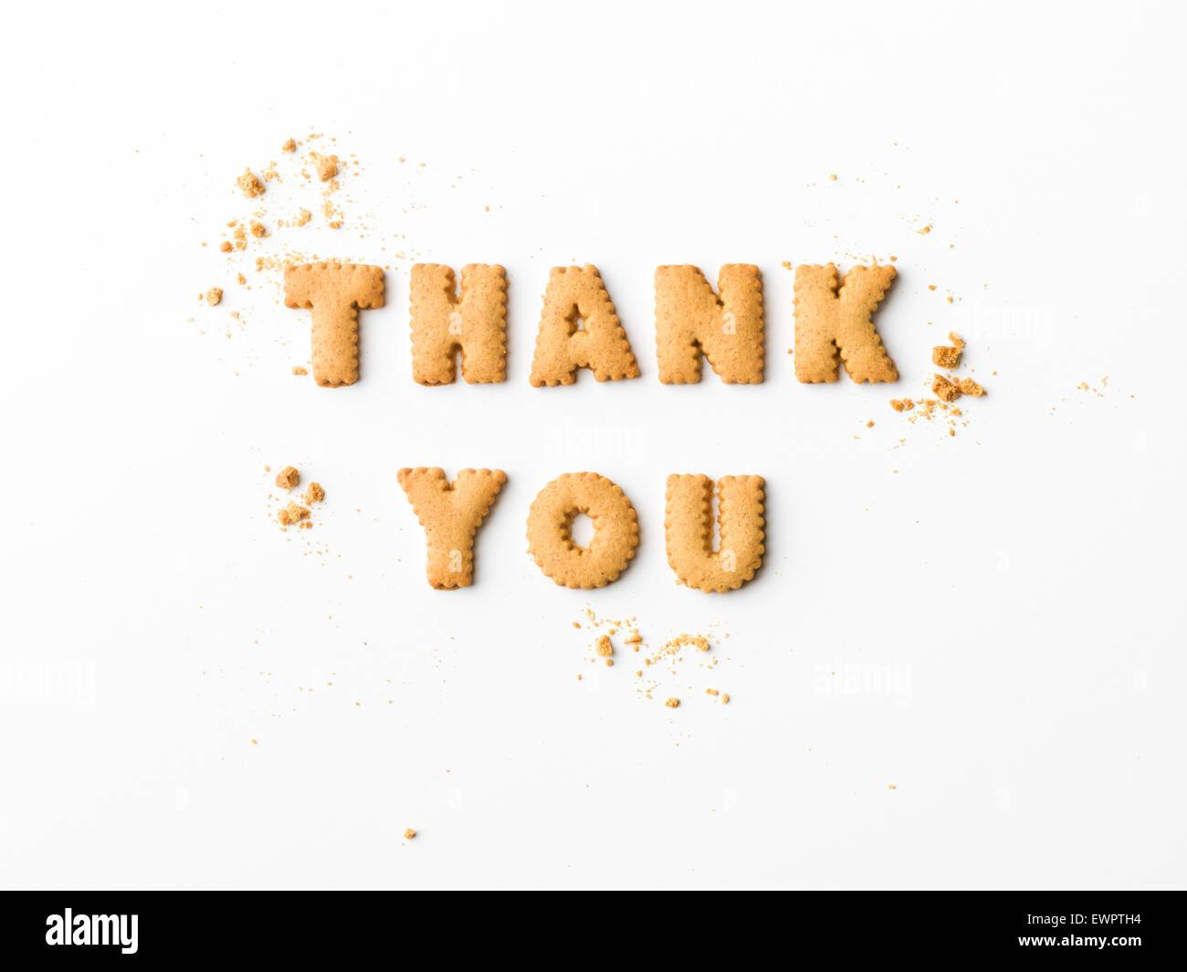 Je vous remercie message écrit avec lettre de biscuits, sur fond blanc Photo Stock