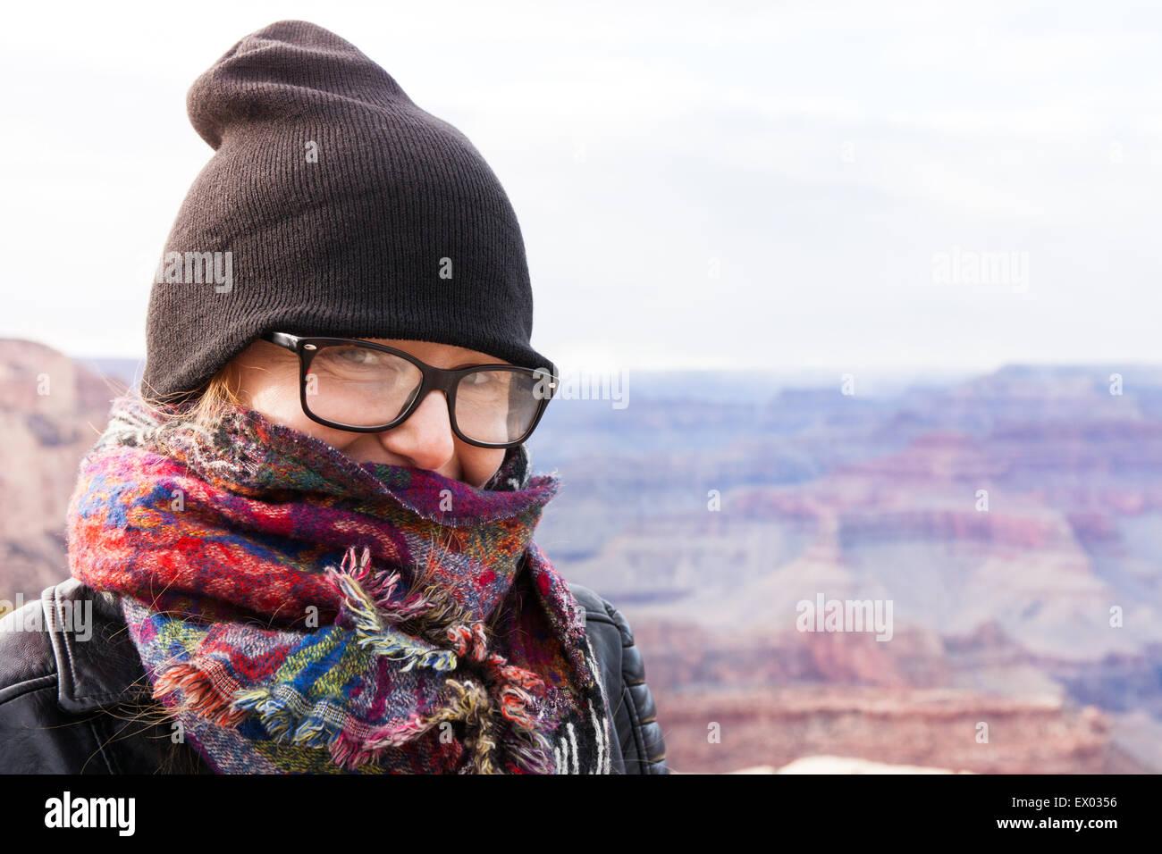 Woman wearing hat and scarf, Grand Canyon, Arizona, USA Photo Stock