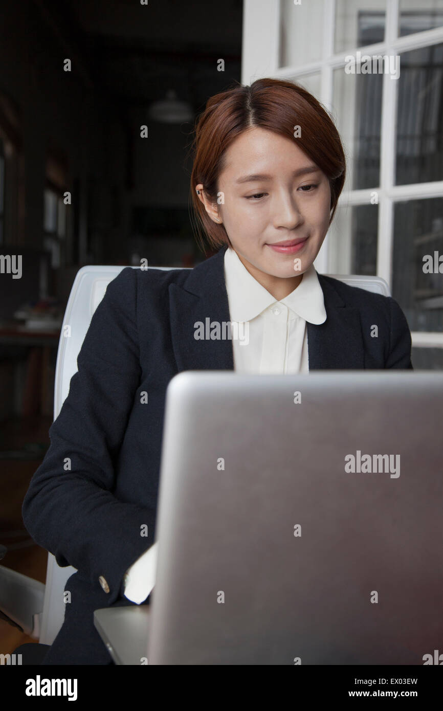 Businesswoman working on laptop Photo Stock
