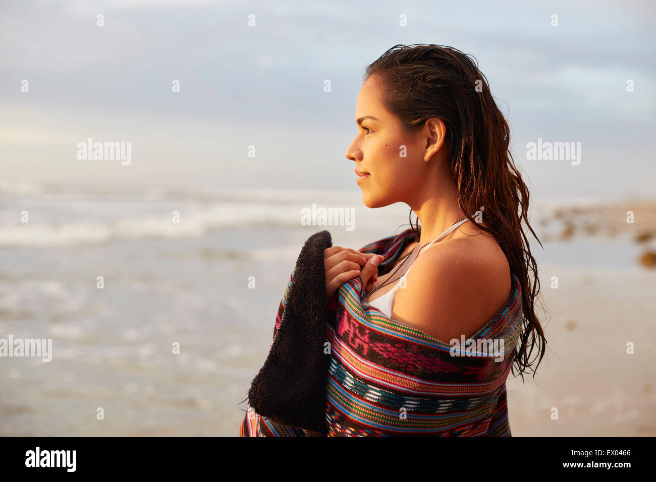 Portrait of young woman wrapped in towel on beach, San Diego, California, USA Banque D'Images