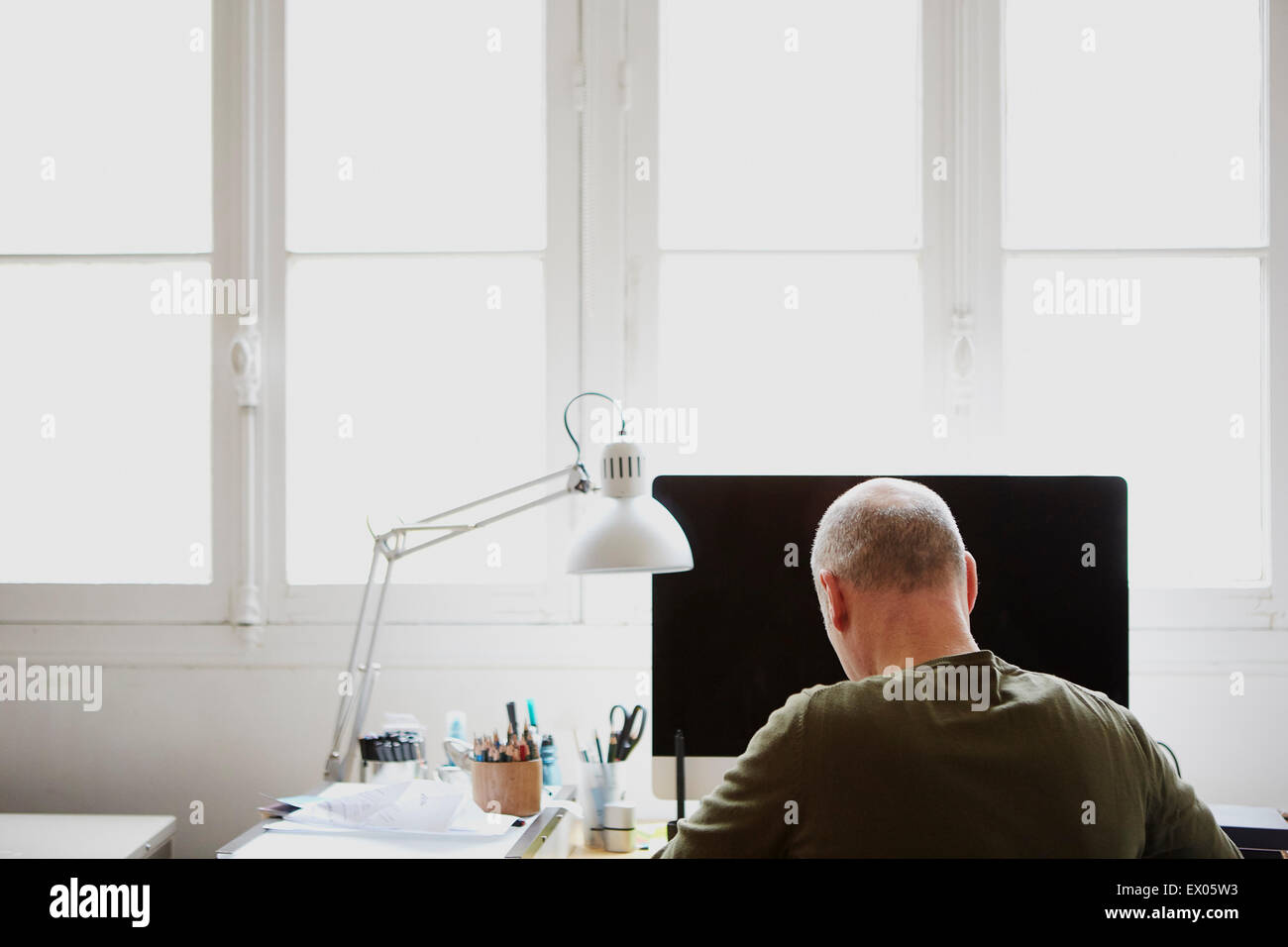 Man in creative studio Photo Stock