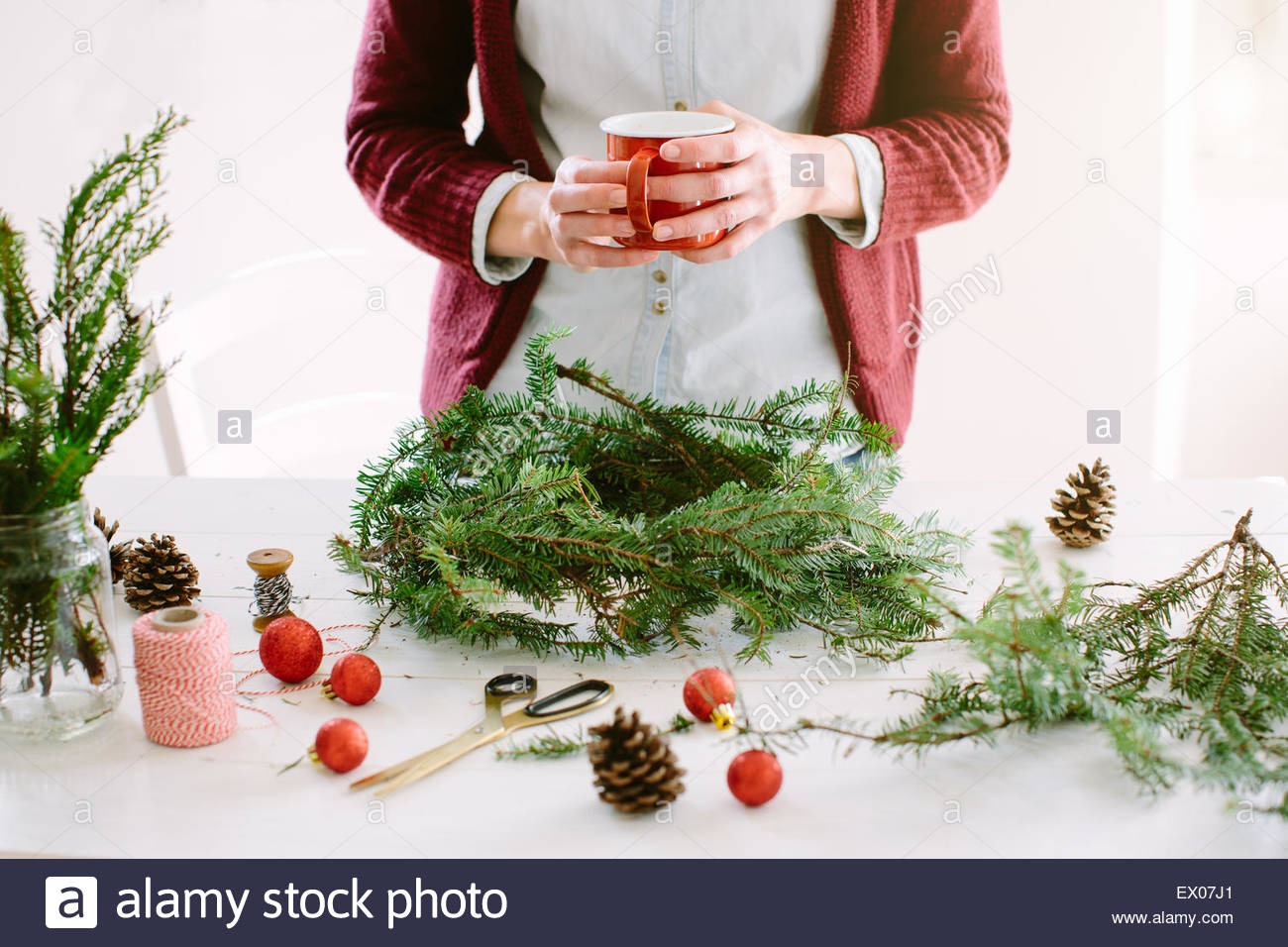 Woman decorating Christmas wreath Photo Stock