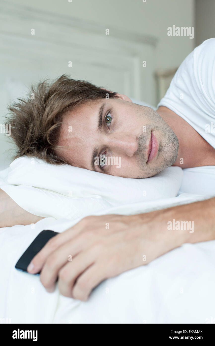 Man relaxing on bed Photo Stock