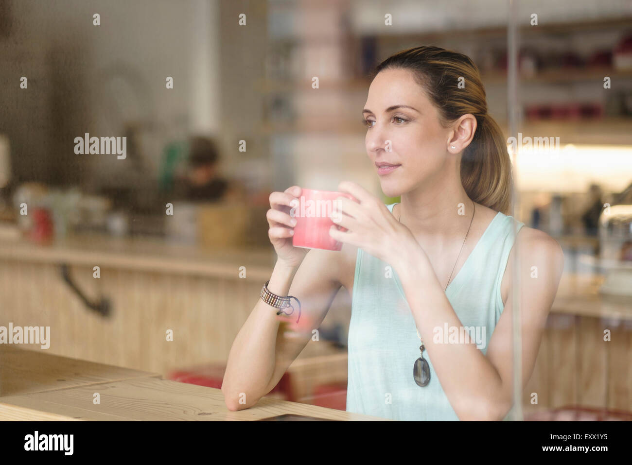Woman holding Coffee cup in cafe Photo Stock