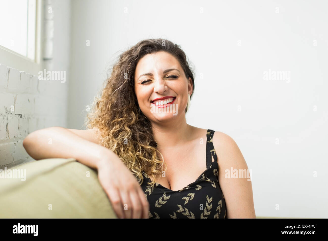 Woman Laughing with closed eyes Photo Stock