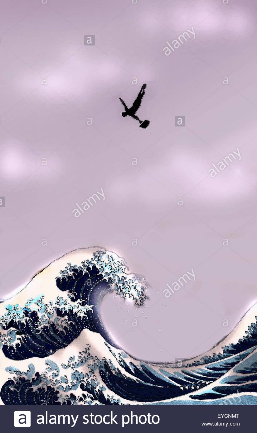 Businessman plongée la tête la première dans les vagues de l'océan Photo Stock