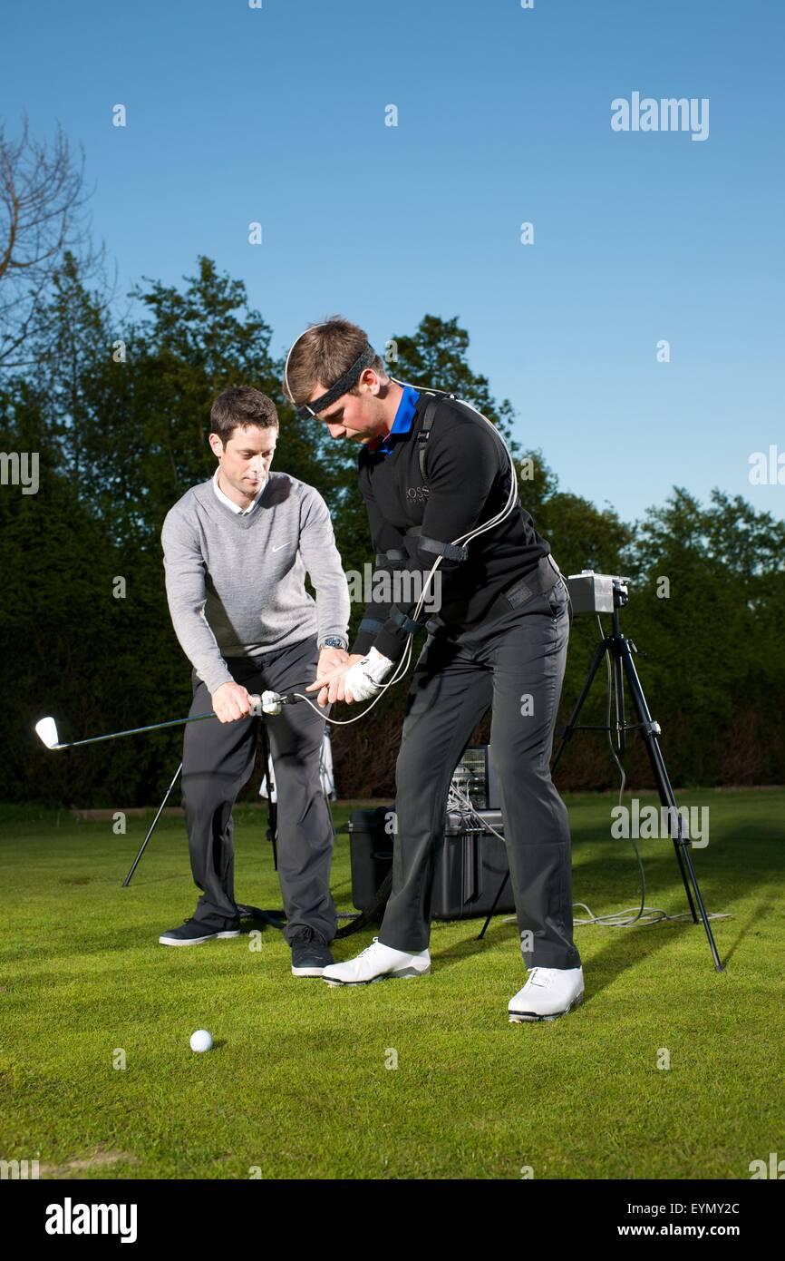 L'entraîneur de golf l'enseignement pendant la leçon Photo Stock
