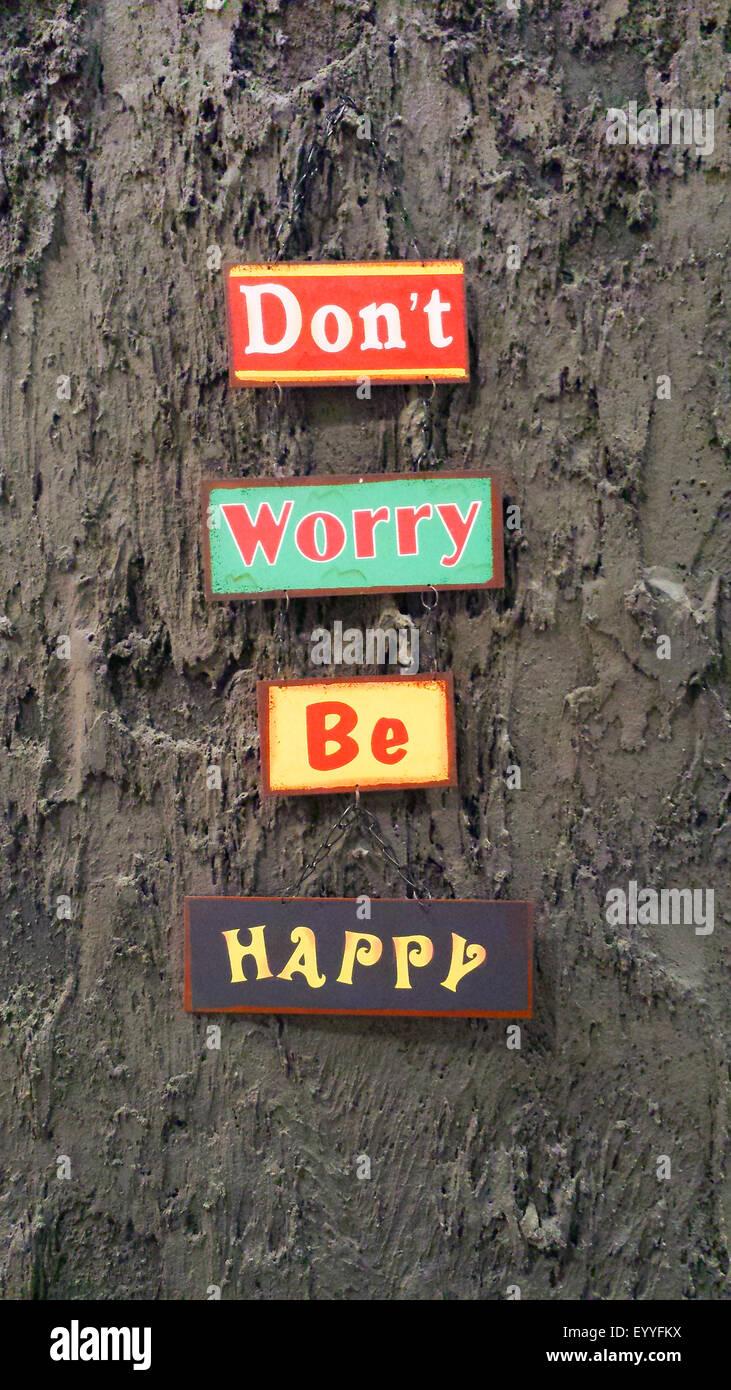"""Les meilleurs prix pour votre être heureux"""" des affiches à un mur Photo Stock"""