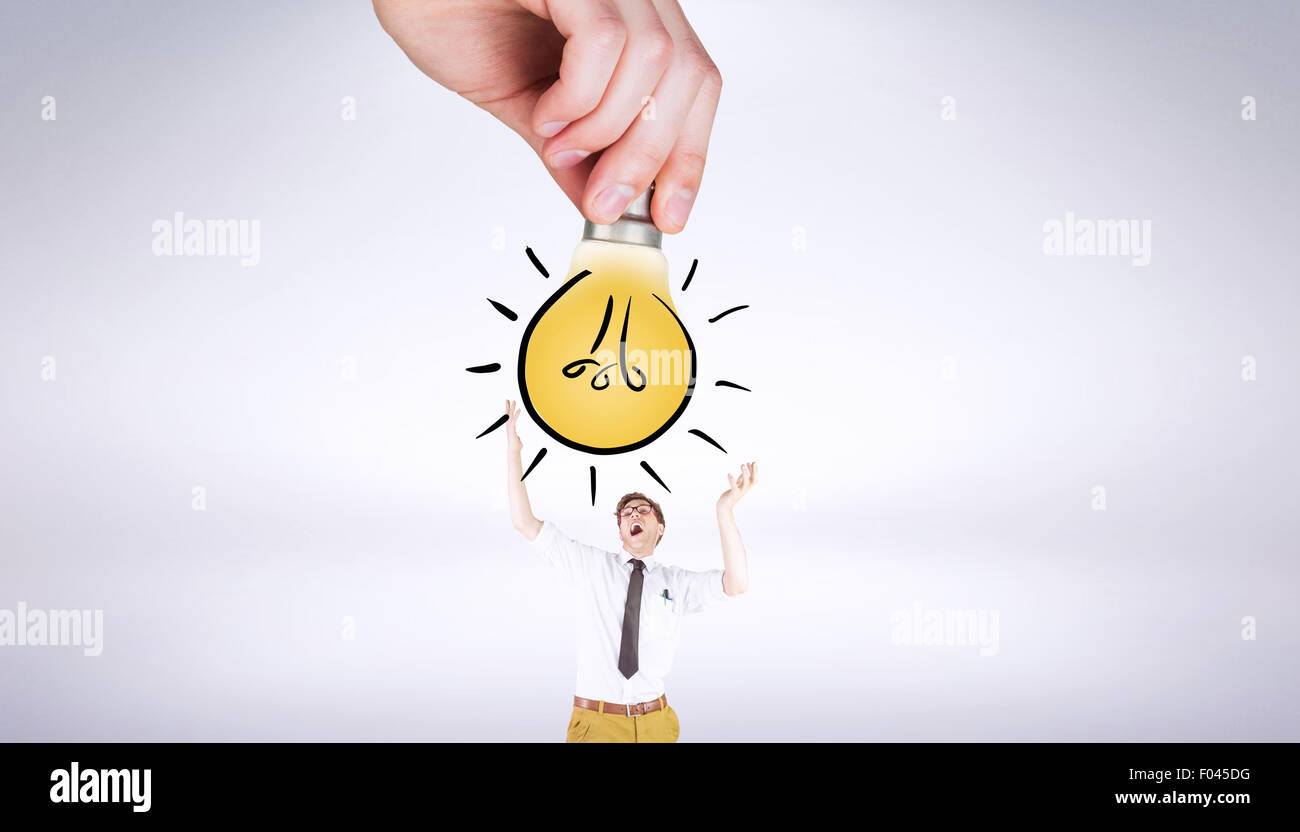 Image composite de hand holding Light bulb doodle Photo Stock