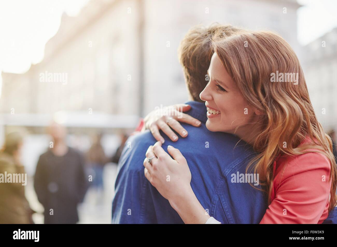 Couple hugging on street, London, UK Photo Stock