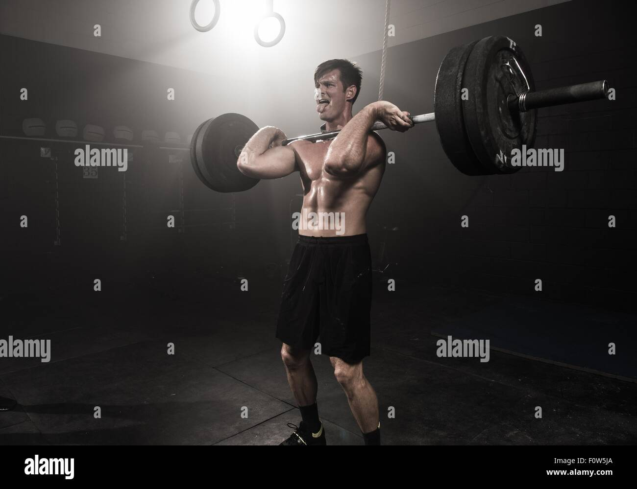 Mid adult man lifting barbell Photo Stock