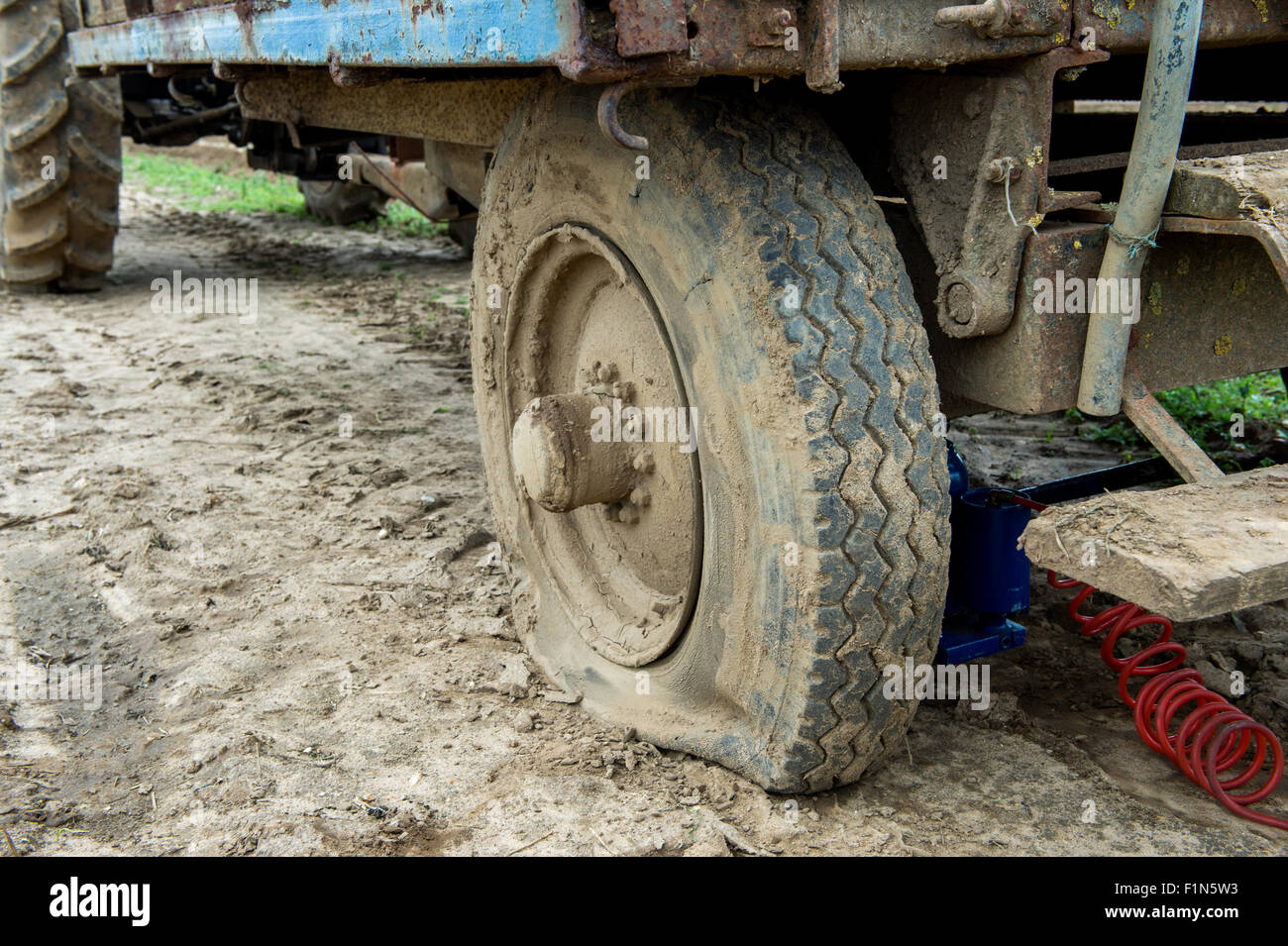 wheel punctured tyre photos wheel punctured tyre images alamy. Black Bedroom Furniture Sets. Home Design Ideas