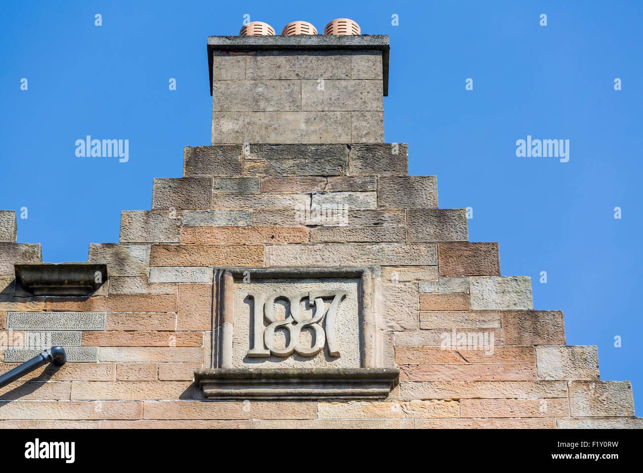Merchant City Glasgow. Une pierre de 1887 sur une cheminée de maison, Écosse, Royaume-Uni Banque D'Images