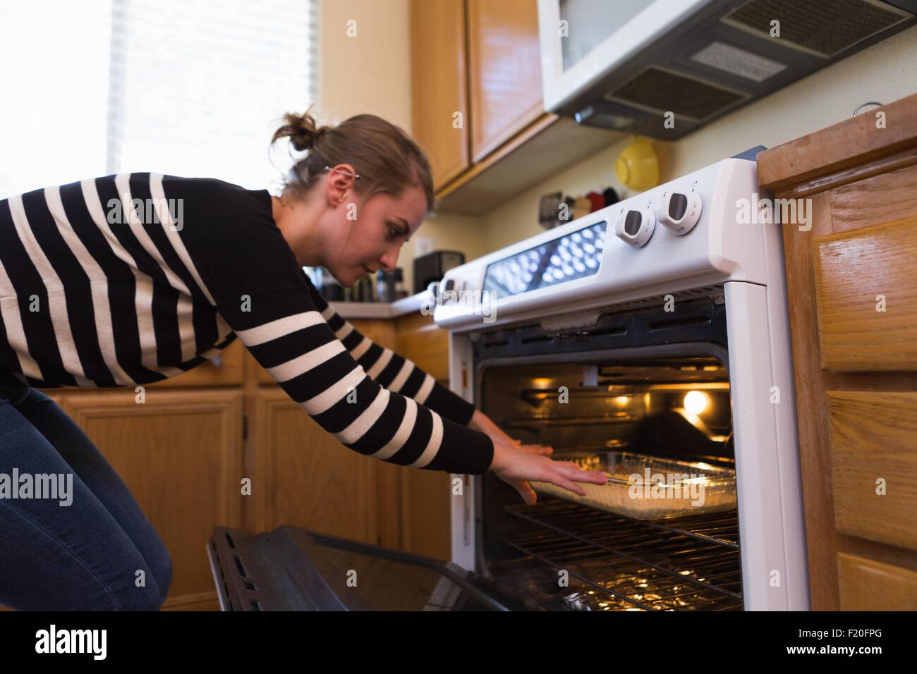 Woman baking in kitchen Photo Stock
