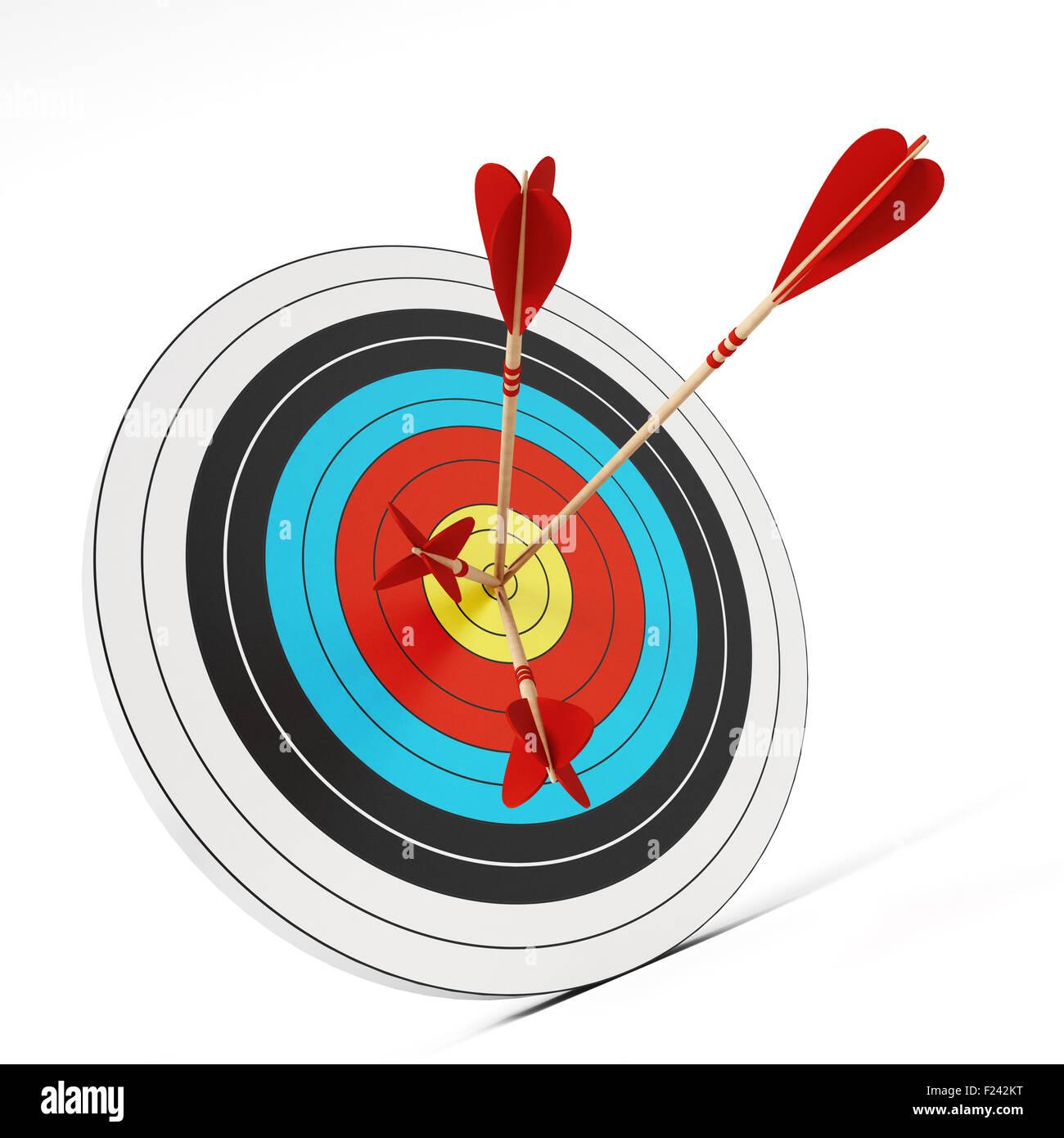 Trois flèches au centre de la cible. Photo Stock
