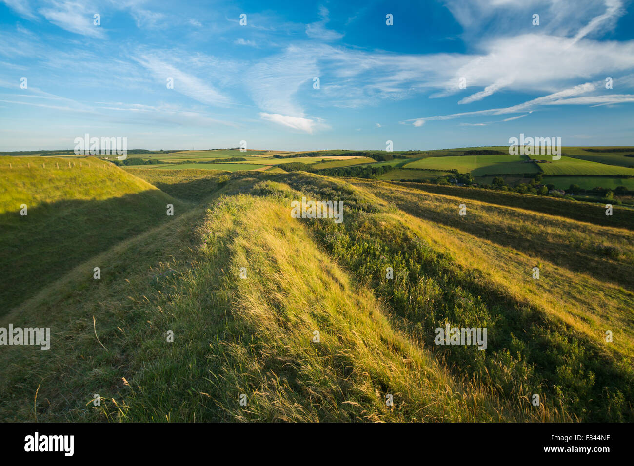 Les remparts de l'ouest Maiden Castle, une commune près de Dorchester, Dorset, England, UK Photo Stock