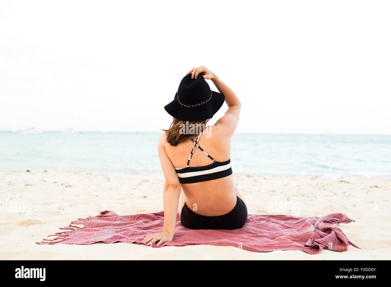 Woman in bikini relaxing on beach Photo Stock