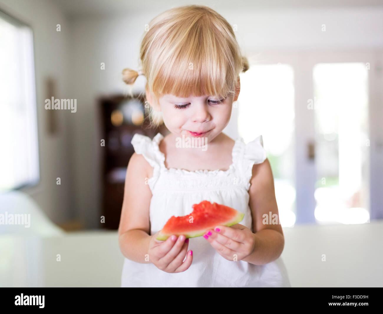 Portrait of Girl (2-3) eating watermelon Photo Stock