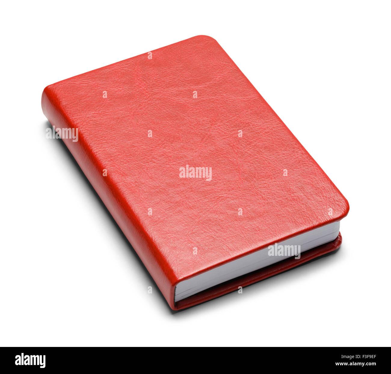 Livre rouge fermé avec copie espace isolé sur fond blanc. Photo Stock