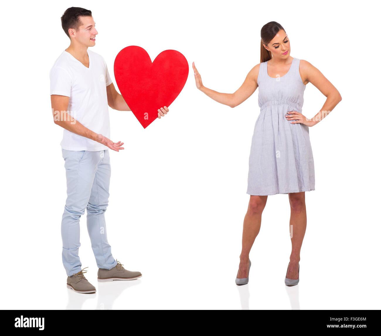 Jeune homme été rejetée par une fille isolée sur fond blanc Photo Stock