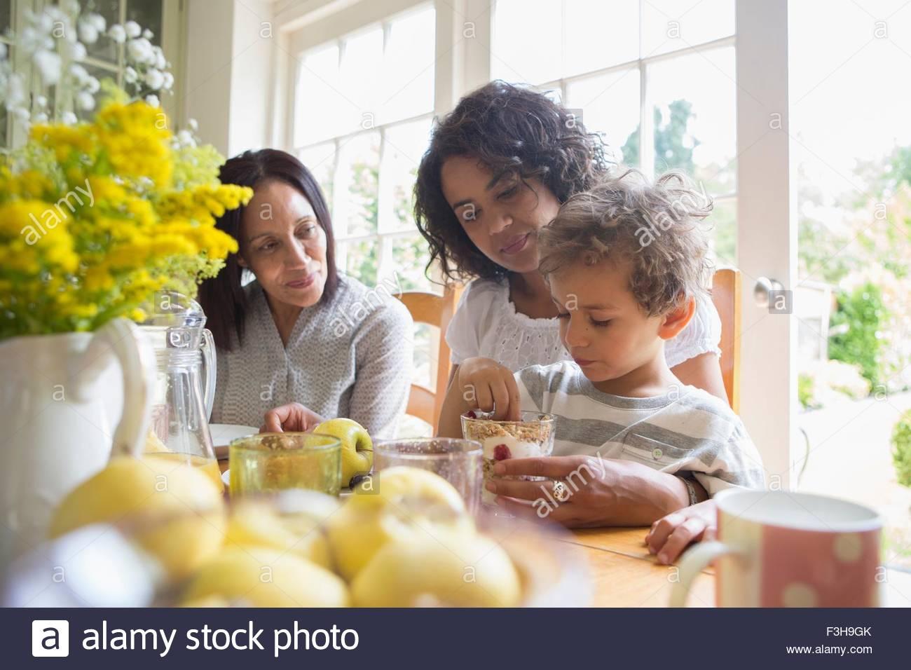 Three generation family eating breakfast ensemble Photo Stock