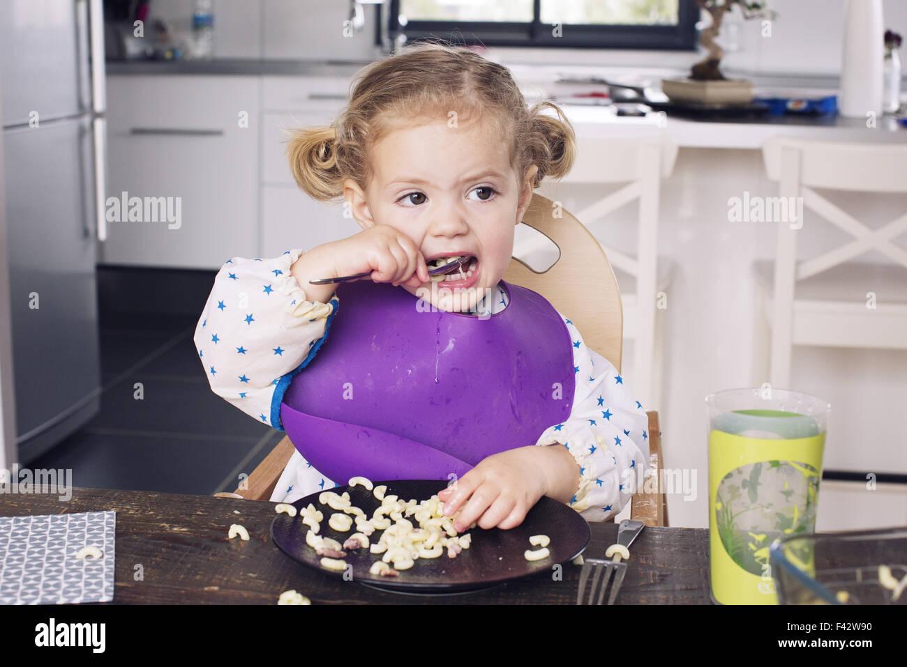 Little girl eating lunch Photo Stock