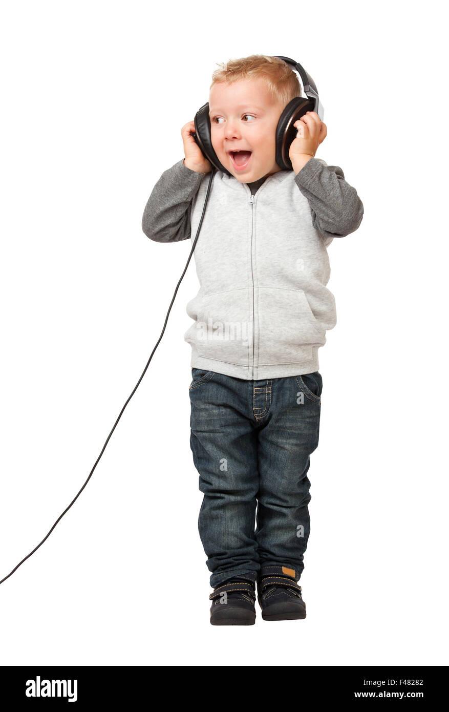 Petit enfant avec casque on white Photo Stock