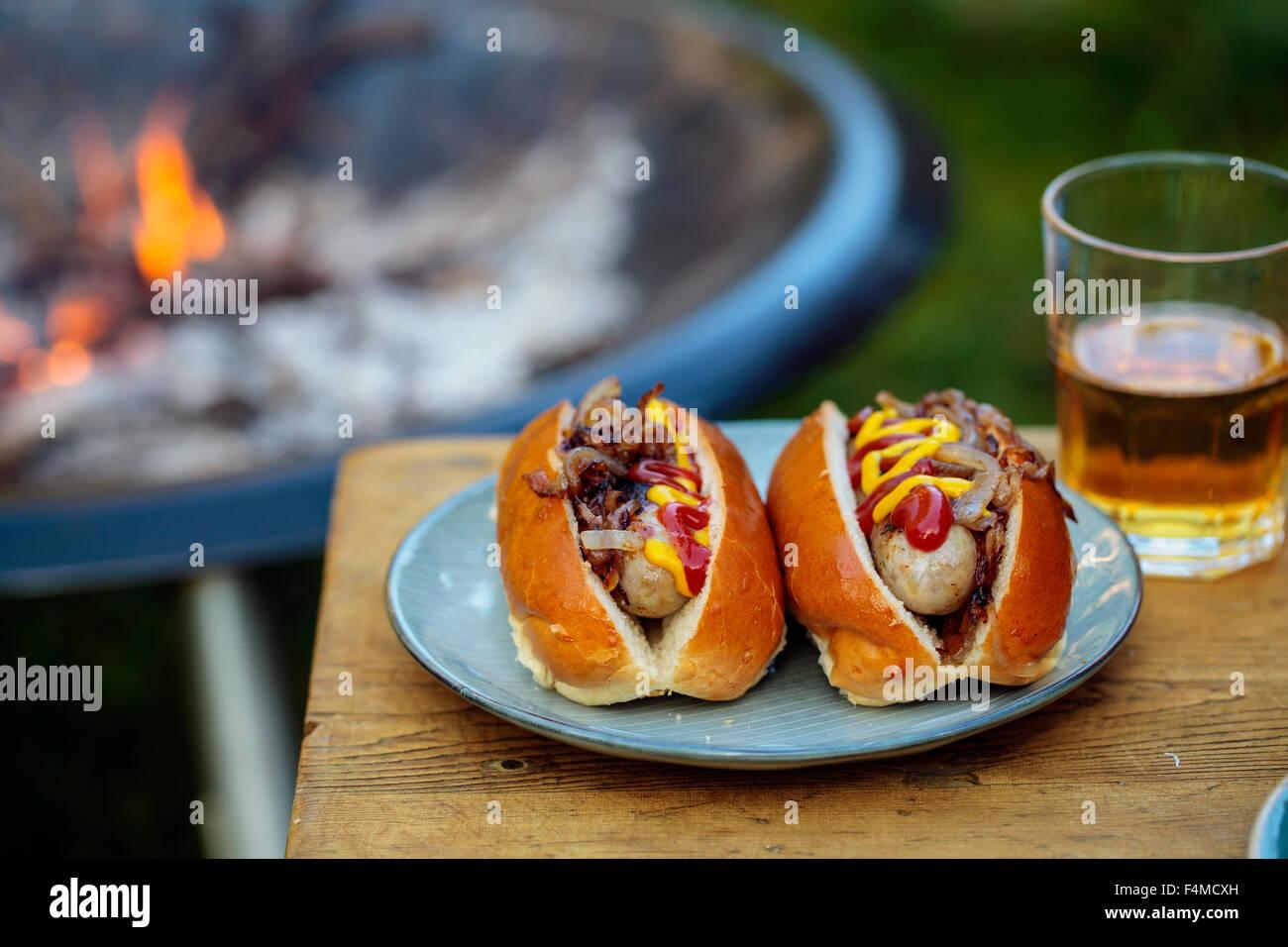 Hot-dogs avec des oignons frits Photo Stock