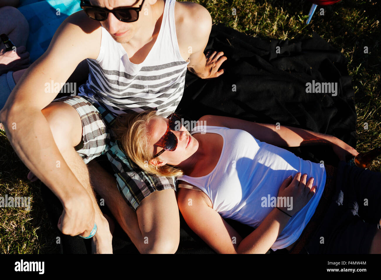 High angle view of woman and man relaxing at picnic Photo Stock