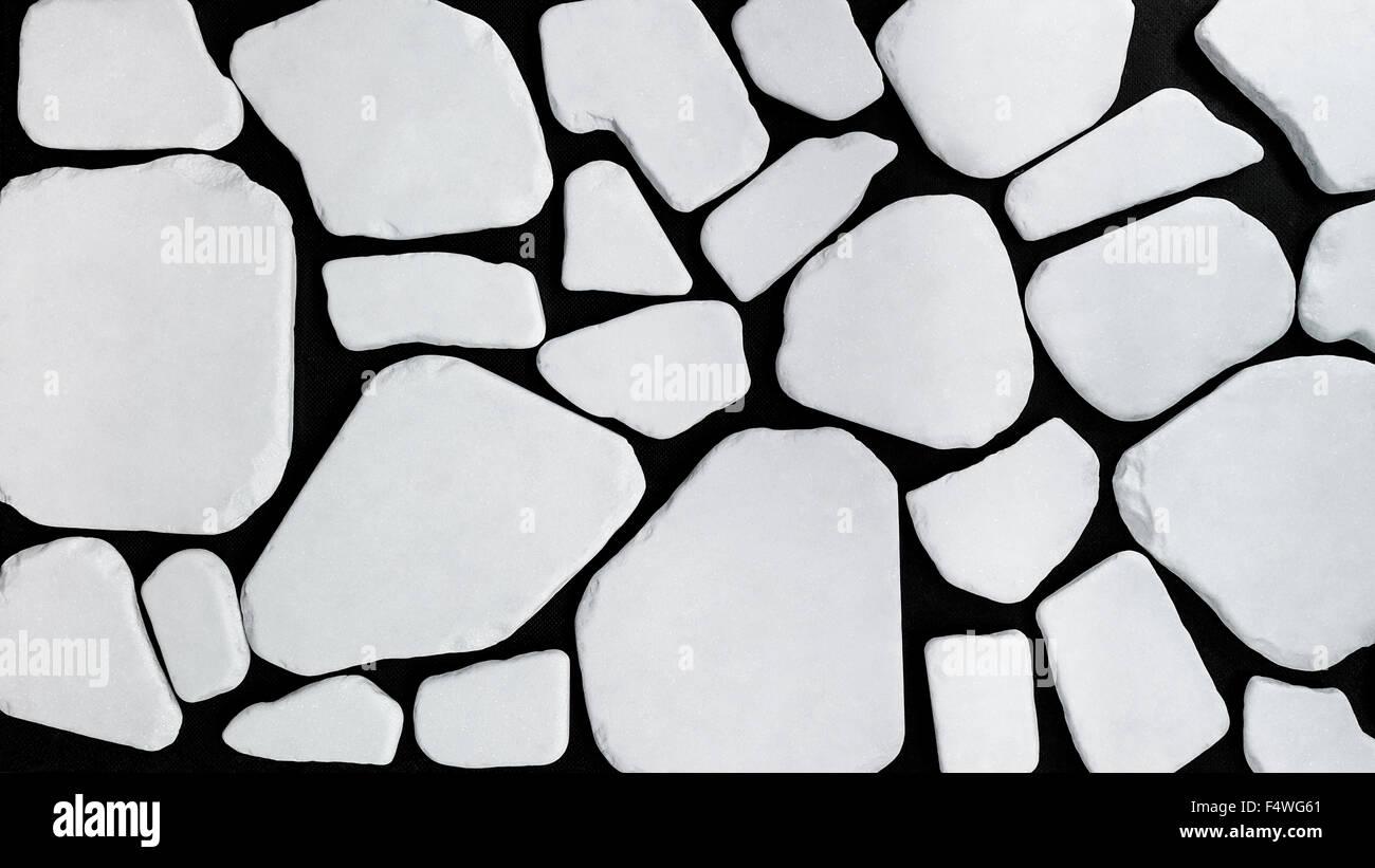 Image d'une mosaïque faite de différentes pièces d'un fluide, la pierre blanche. Elles sont Photo Stock
