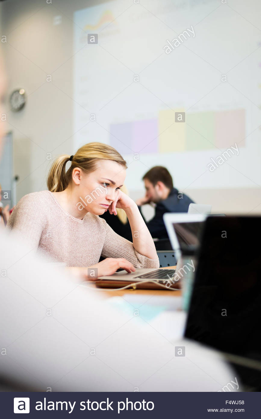 Woman using laptop in office Photo Stock