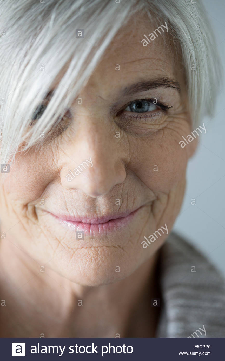 Close up portrait of smiling senior woman Photo Stock