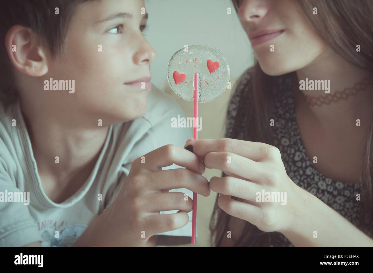 Boy and girl holding valentine day's lollipop Photo Stock