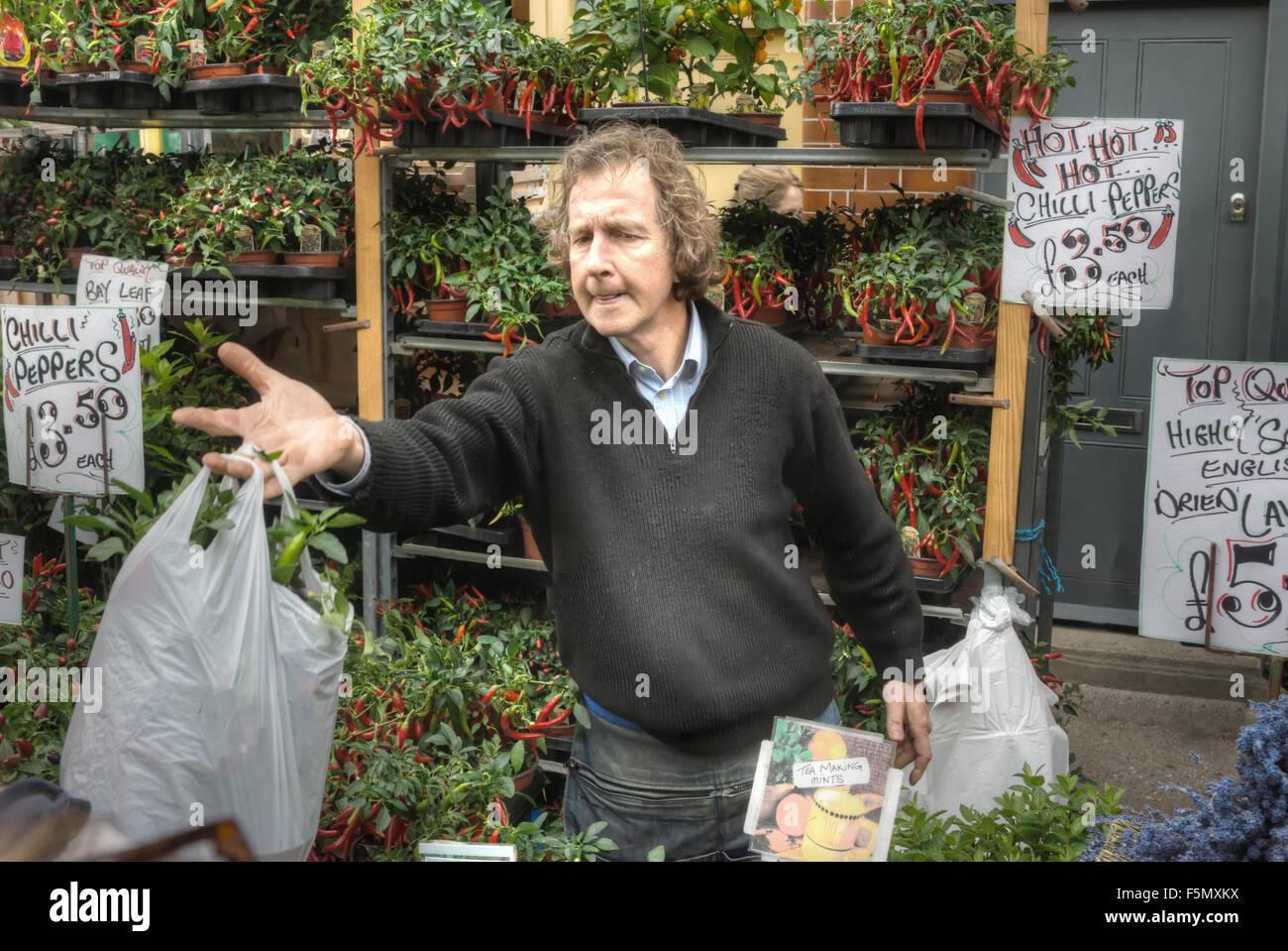 Titulaire de décrochage, Columbia Road Flower Market. Londres Photo Stock