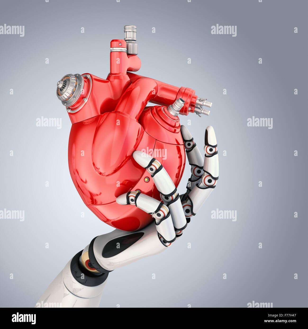 Coeur mécanique dans la main des robots. Chemin de détourage inclus Photo Stock