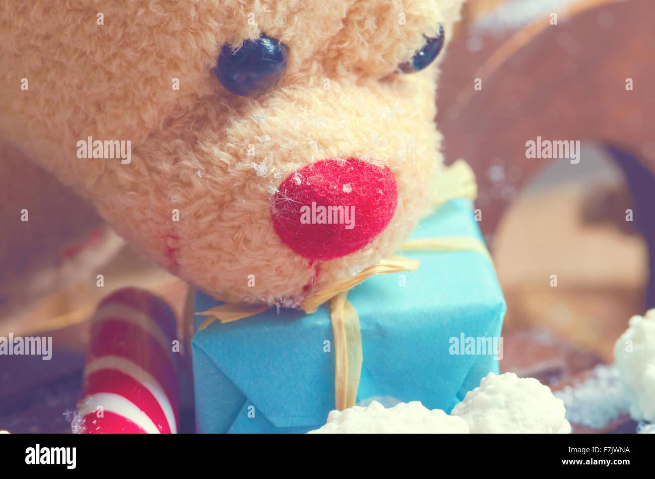 Ours de Noël avec Candy Cane et bleu présente Photo Stock