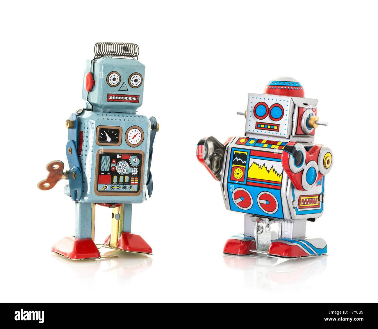Boîte métallique rétro deux robots sur un fond blanc Photo Stock