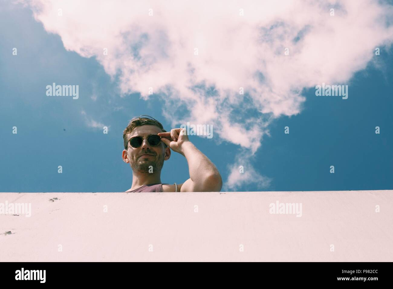 Low Angle View of Young Man Against Sky Photo Stock