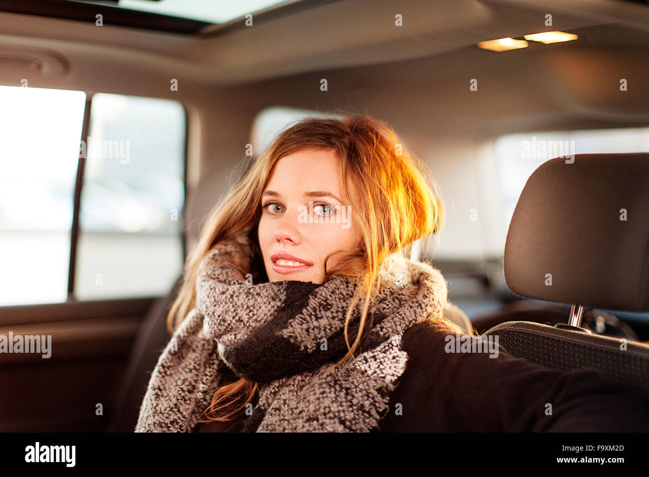 Portrait of smiling woman in a car Photo Stock