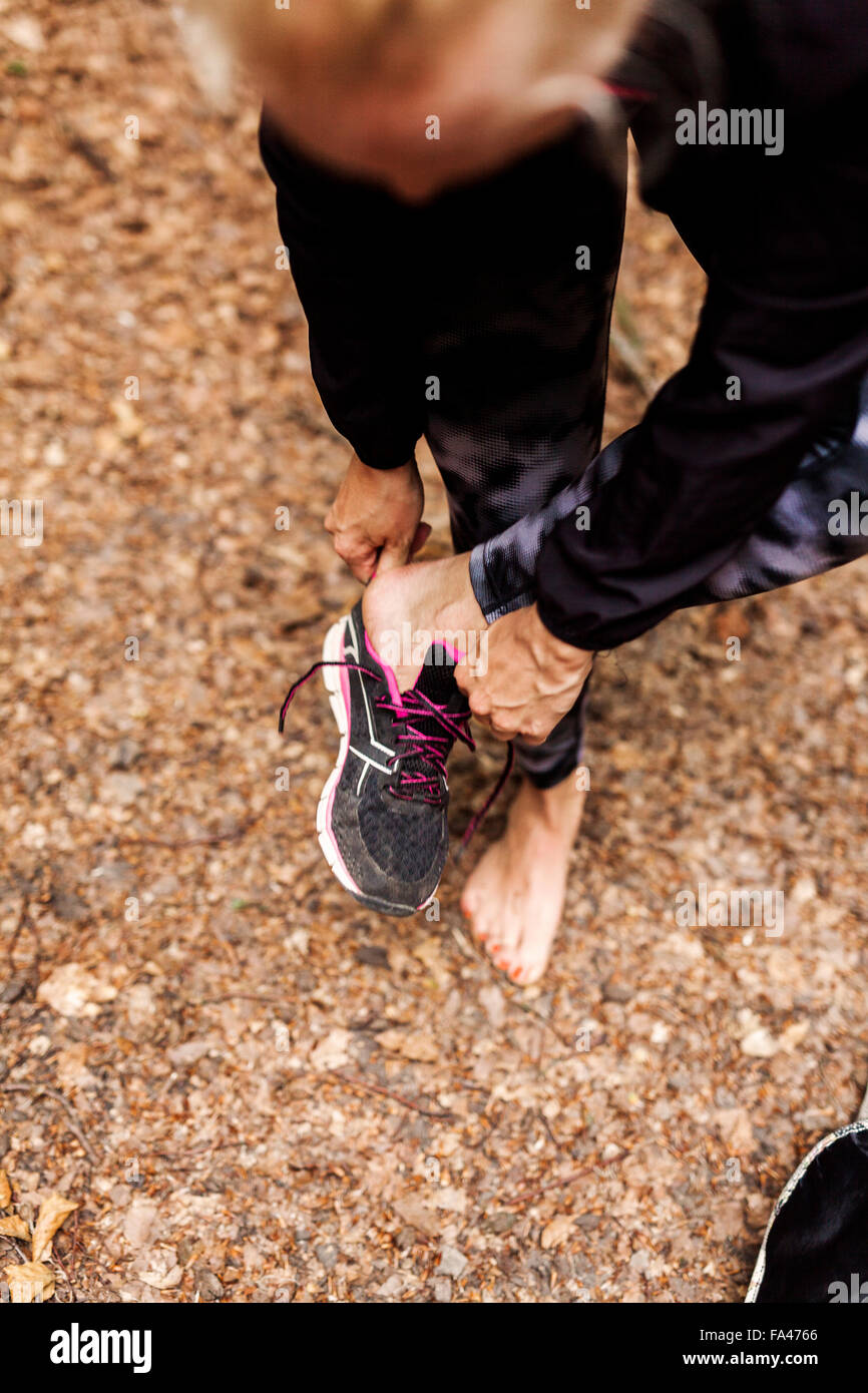 High angle view of woman wearing sports shoe at park Photo Stock