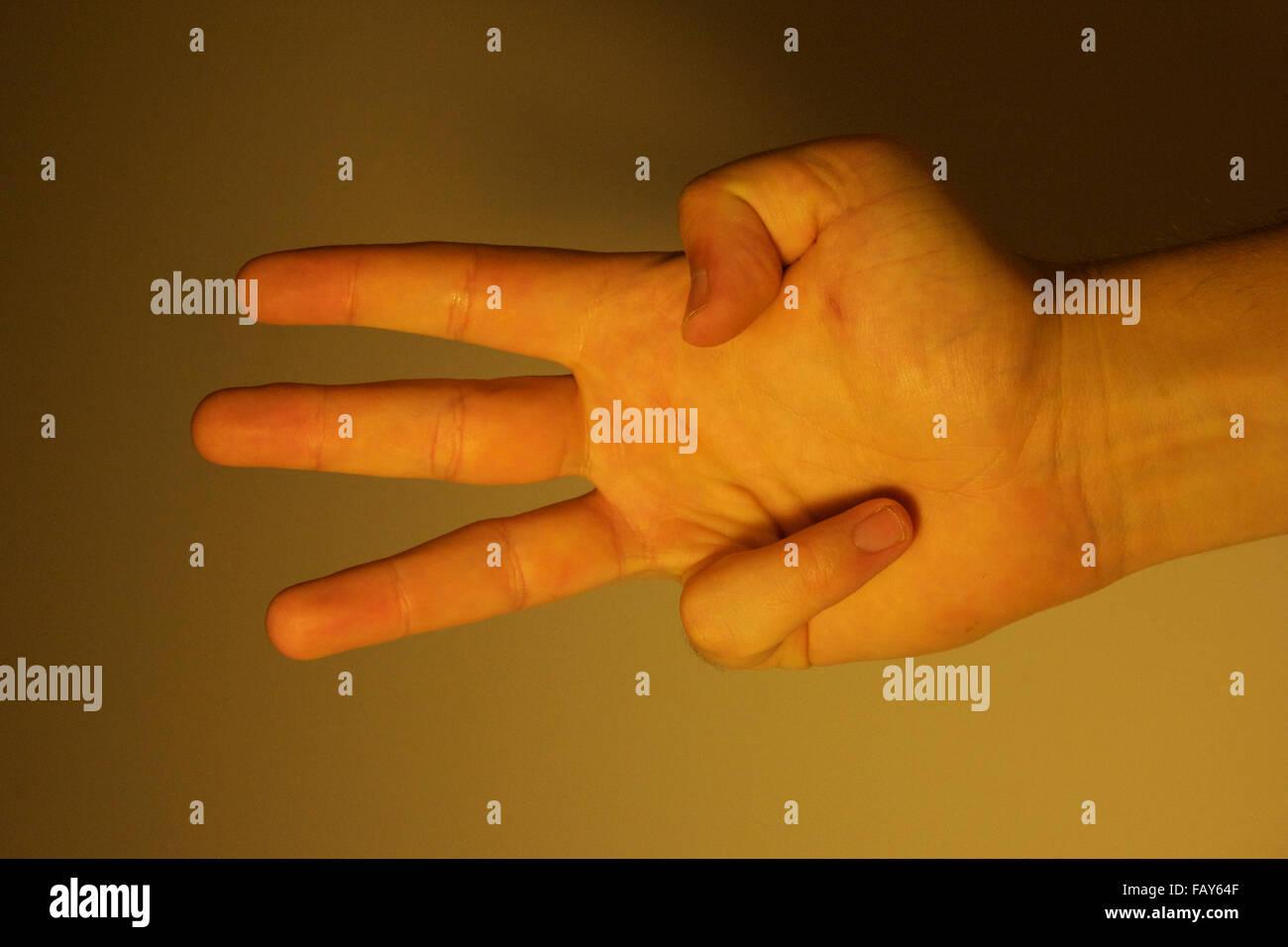 Trois doigts. Photo Stock